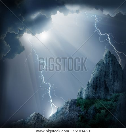 stormy clouds with lightnings over  mystic mountains