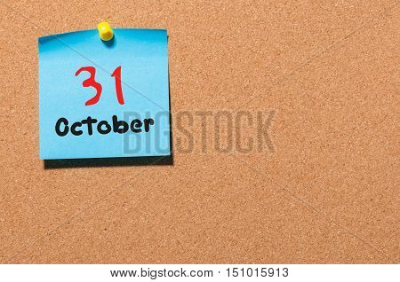 October 31th. Day 31 of month, color sticker calendar on notice board. Autumn time. Empty space for text.