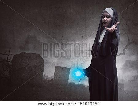 Awful Asian Woman Nun With Magic Blue Power