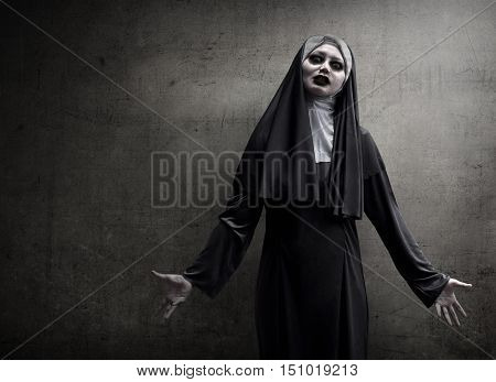 Asian Woman Dressed In Evil Nun