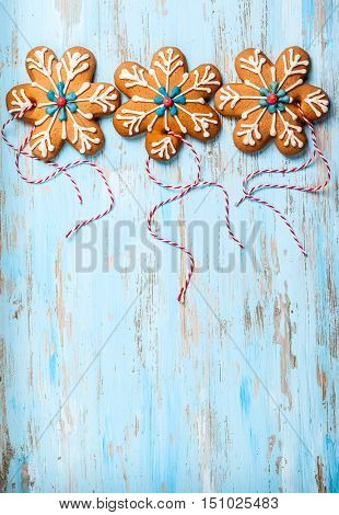 Gingerbread snowflakes for Christmas on a blue wooden background
