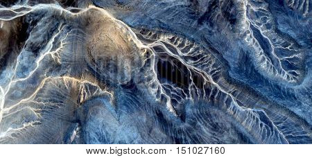 looking sperm to ovum in the uterus desert, abstract landscapes of deserts of Africa from the air, mirage in the desert, textures and turquoise denim fabric, abstract naturalism,