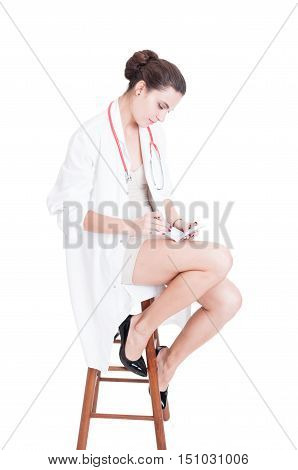 Elegant Woman Doctor Sitting On Chair