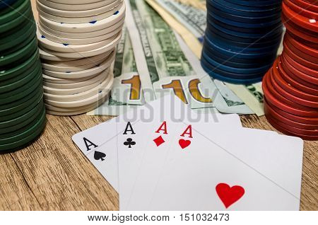 four aces with chips and us dollar