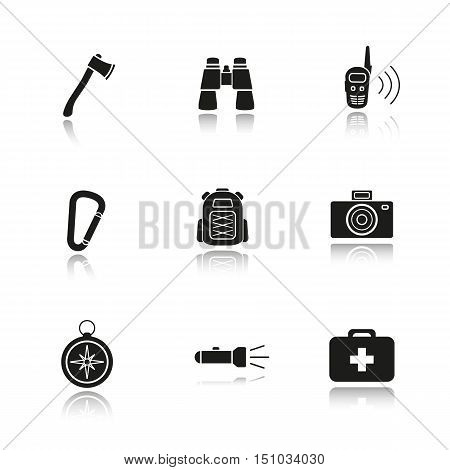 Camping gear drop shadow black icons set. Axe, binoculars, walkie-talkie, carabiner, backpack, photo camera compass, flashlight and first aid kit. Tourist's equipment. Isolated vector illustrations