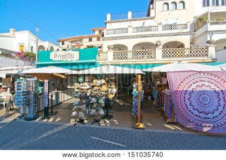 PUERTO SOLLER MALLORCA SPAIN - OCTOBER 2 2016: Primitiv store with hats souvenirs and fashion on a sunny day on October 2, 2016 in Puerto Soller, Mallorca, Spain.