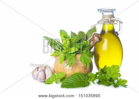 Olive Oil And Fresh Herbs And Spices On White Background