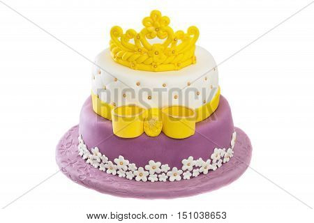 Birthday cake with sugar paste. On birthday. with crown and bow.