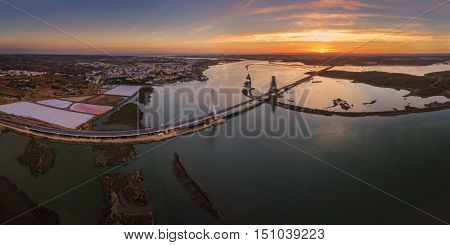 Horizontal view of the river Arade bridge. Sunset. Portugal.