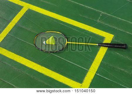 Badminton racket and shuttlecock - sport background
