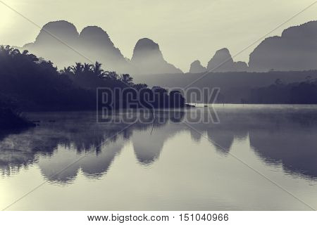 Beautiful sunrise and reflections at natural lagoon Nongtalay lagoon in Krabi Province Thailand. Black & White.