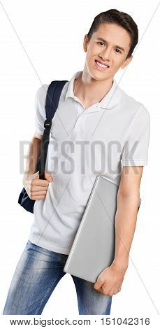 Young happy student posing while holding a notebook and a backpack