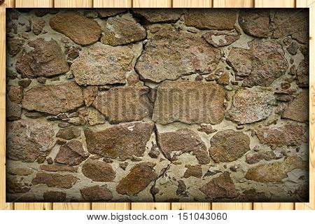Background texture and pattern of a natural rough stone wall with uncut sandstone rocks in mortar in an architectural concept full frame