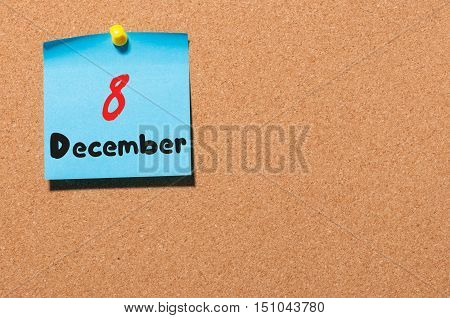 December 8th. Day 8 of month, Calendar on cork notice board. Winter time. Empty space for text.