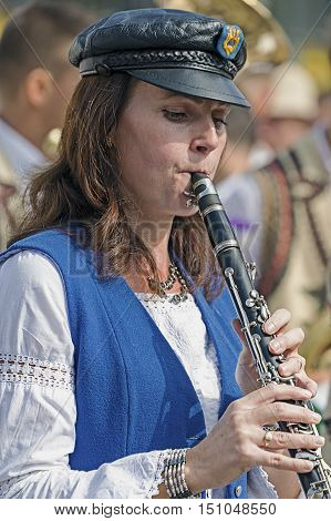 TIMISOARA ROMANIA - SEPTEMBER 25 2016: Woman singer ethnic German from Banat Romania playing at clarinet with occasion of Festival of ethnic groups