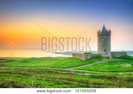 Beautiful irish castle near Atlantic ocean at sunset, Co. Clare