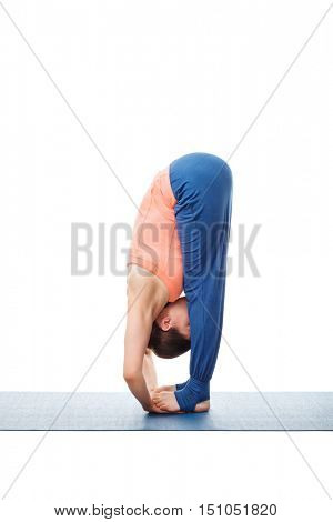 Woman doing Ashtanga Vinyasa Yoga asana Padahastasana - standing forward bend with hand under feet pose posture isolated on white background