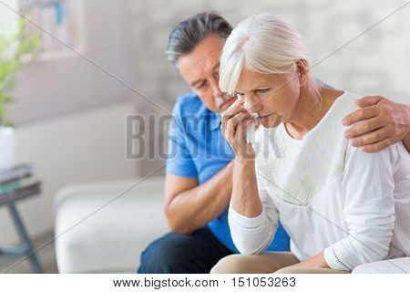 Senior Man Consoling Wife