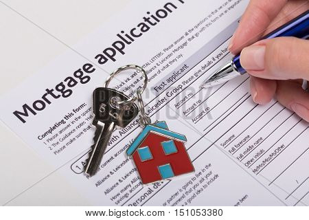Mortgage Application Form being Filled out by a New Home Buyer