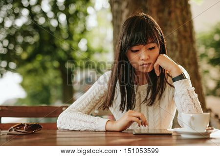 Attractive Girl Using Digital Tablet At Coffeeshop