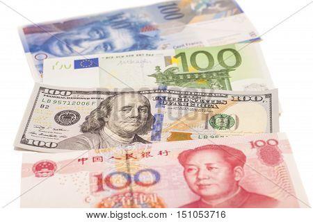 American dollars European euroSwiss franc and Chinese yuan bills