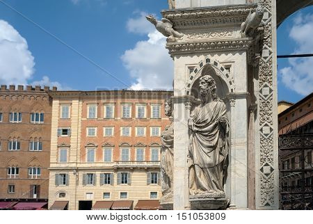 SIENA, ITALY - AUGUST 30, 2016: siena (Italy, Tuscany): detail of the decoration over the facade of the Palazzo Pubblico, in the Piazza del Campo, world famous for the historical Palio.