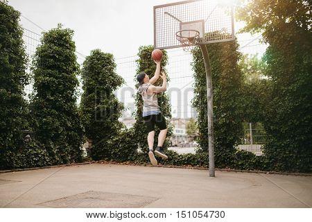 Teenage Guy Playing Streetball