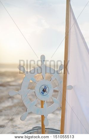 sea background decoration sail and cardboard helm