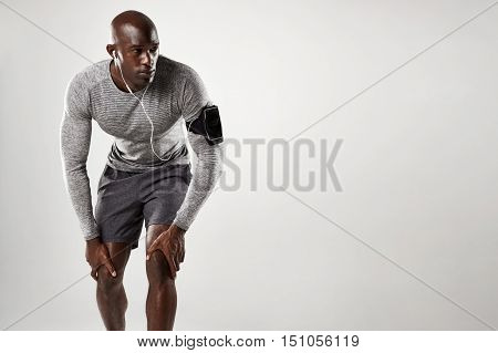 Muscular Male Model With Armband And Earphones