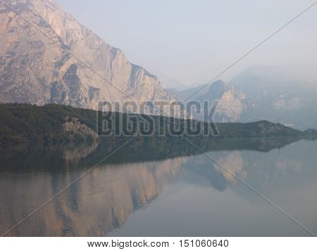 Reflection Of Mountains In The Water Of Lago Cavedine