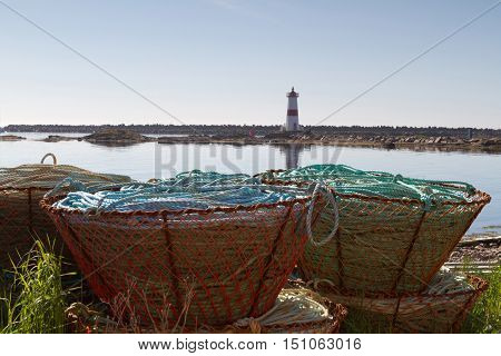 Crab fishing pots with lighthouse in background.