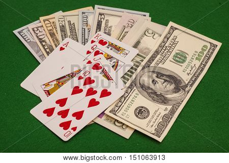 Royal Flush Hearts And Dollar Money On Green Felt