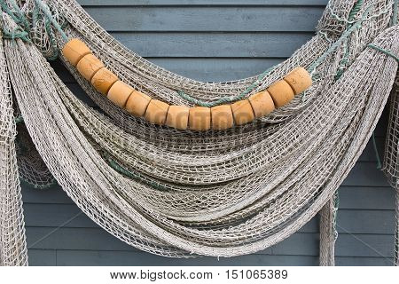 Fishing net hanging on the side of a fishing stage.