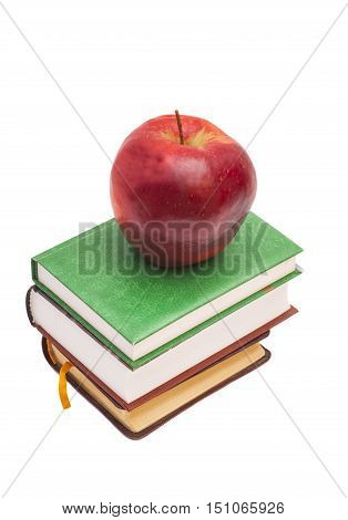 Red apple on a books isolated on white
