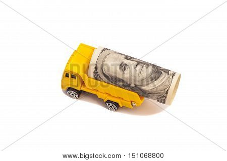 truck caries a roll of one hundred dollar bill isolated on white background