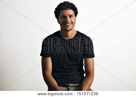 Smiling happy healthy African American model wearing a blank cotton short-sleeved t-shirt isolated on white