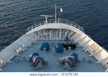 Bow of ship with anchor steaming .