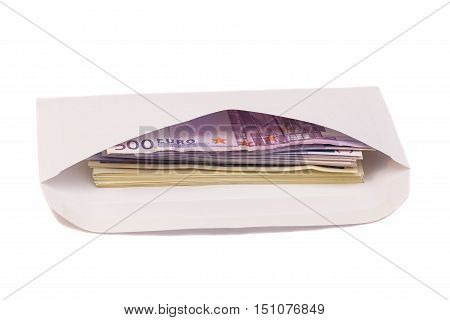 euro and dollars in open envelope isolated on white