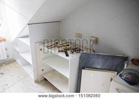 Buildings iInstruments for repair on white wooden furniture in light penthouse room.