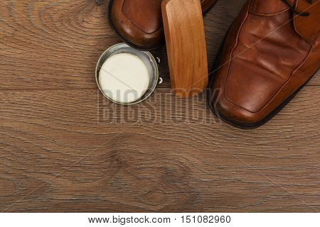 Shoes And Cleaning Equipment On A Wooden Floor