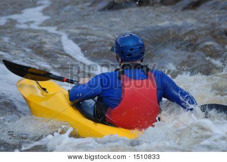 Yellow Kayak In Rapids