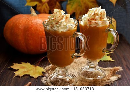 Pumpkin spice latte with whipped cream in glasses autumn seasonal beverage