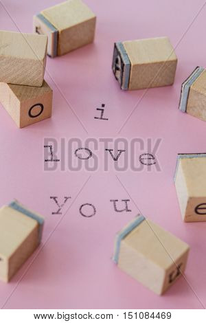 I love you written with rubber stamps on pink