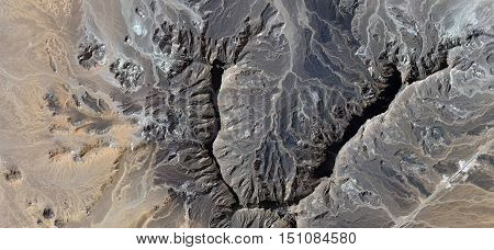 heart of stone,abstract surrealism, abstract photography deserts of Africa from the air,Abstract Naturalism, mirages, fantasy landscape eroded by water, deep cracks, fantasy landscape eroded by water,