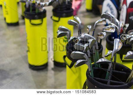 Many types of golf club in golf shop.