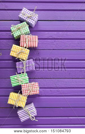 Little presents for christmas on a rustic purple background