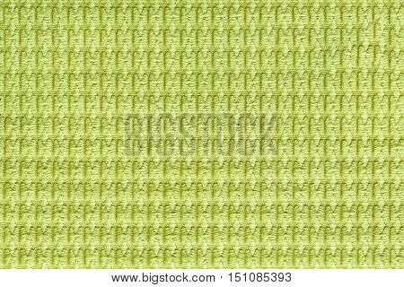 Light green background from soft fleecy fabric close up. Texture of textiles macro.