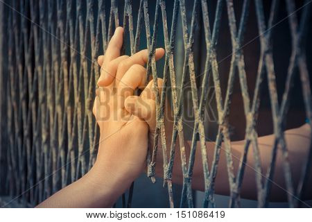 Hands Of The Man And Woman On A Steel Lattice
