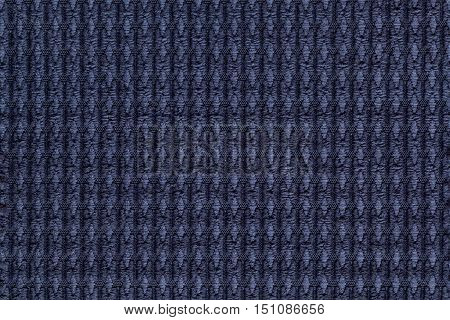 Navy blue background from soft fleecy fabric close up. Texture of textiles macro.