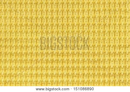 Bright yellow background from soft fleecy fabric close up. Texture of textiles macro.